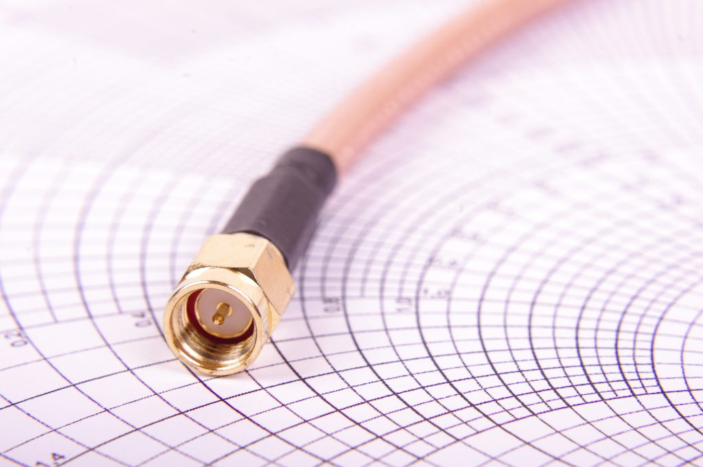 Macro close up of radio frequency cable with SMA connector on the Smith chart